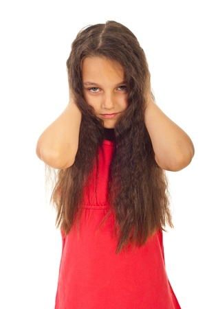 Unhappy girl with attitude covering ears to not hear you isolated on white background Stock Photo - 9886200