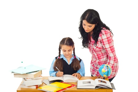 Mom helping daughter with homework isolated on white background photo