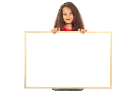 Smiling girl seven years old holding blank banner isolated on white background photo