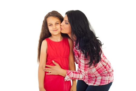 Mother kissing her daughter isolated on white background Stock Photo - 9886102