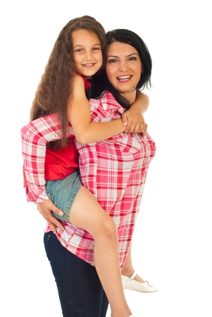 Happy mother giving piggy back ride to her daughter iosolated on white background photo