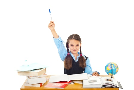 Schoolgirl at school raising hand with pencil :I know the answer!