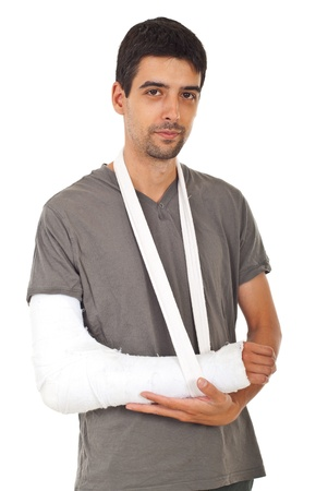 Portrait of young man with broken hand in gypsum isolated on white background photo