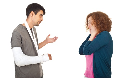 explanations: Injured man giving explanations about what happen to his worried surprised wife isolated on white background
