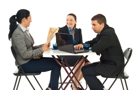 Threee business people sitting on chairs in a cafe shop searching on laptop,reading newspaper and having conversation against white background