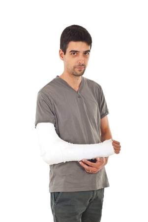 Young man with injured arm isolated on white background photo