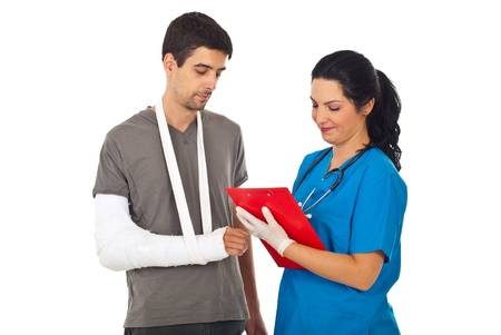 Friendly doctor woman giving prescription to injured man and writing in clipboard isolated on white background