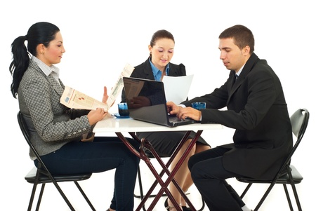 Group of three business people sitting at table in a cafe shop and reading newspaper,reading documents or searching on laptop isolated on white background photo