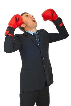 Furious business man with boxing gloves shouting and looking up isolated on white background photo