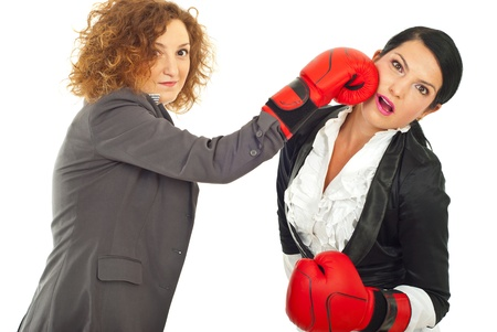 strong women: Two business women fight with boxing glove isolated on white background
