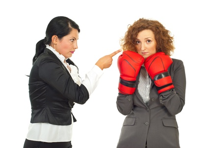 Manager arguing employee woman   isolated on white background,conceptual image of employee woman trying to defend with boxing glove of accuser boss photo