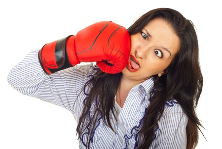 idiot: Funny business woman hot itself with a boxing glove and making a face isolated on white background Stock Photo
