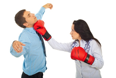 Furious business woman with boxing gloves hit business man isolated on white background photo