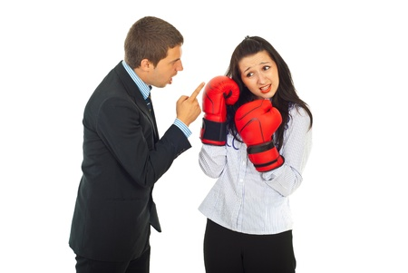 accuser: Angry boss argue employee woman and she tried to defend with boxing gloves isolated on white background Stock Photo