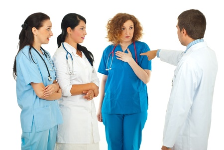 Hospital manager blaming doctor woman  and her colleagues being surprised isolated on white background