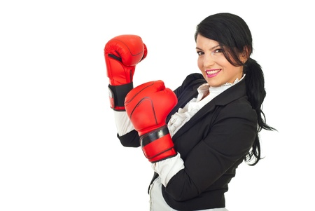 strong strategy: Happy business woman with attitude standing  in semi profile and wearing boxing gloves isolated on white background Stock Photo