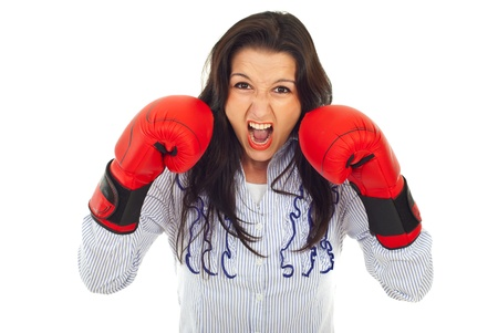 Furious business woman in attack wearing boxing gloves isolated on white background Stock Photo - 10030592