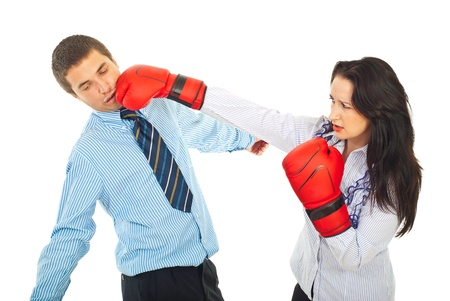 female kick: Business man being kicked by a business woman with boxing gloves isolated on white background Stock Photo