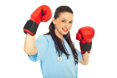 nurse gloves: Successful young physician woman wearing boxing gloves isolated on white background Stock Photo