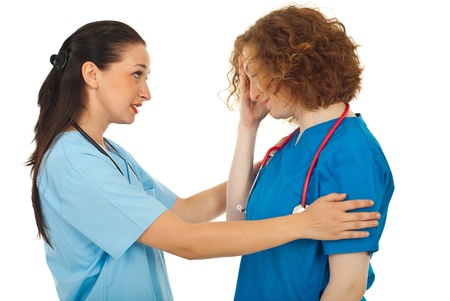 Doctor woman comforting her colleague isolated on white background