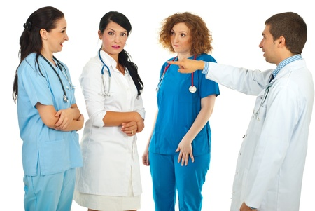 accuser: Accuser male doctor pointing to his team and women being surprised isolated on white background