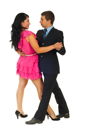 Dancing attractive couple isolated on white background photo