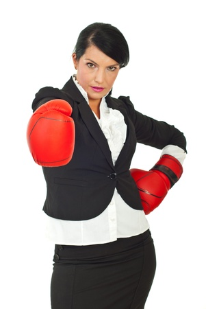 Businesswoman with attitude wearing boxing gloves and being prepared for competition against white background,selective focus on glove photo