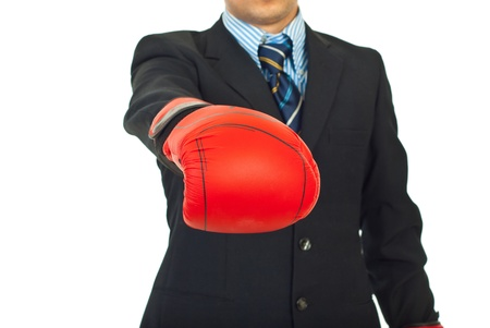Close up of business man showing hand in boxing glove,selective focus on glove photo