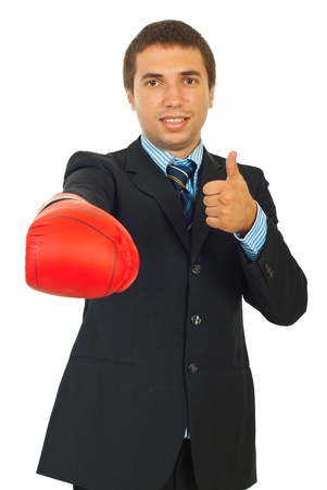 Business man giving thumb up and showing hand in boxing glove isolated on white background photo
