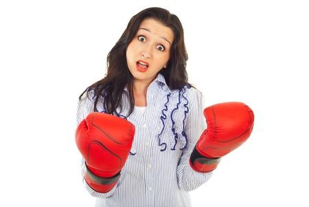 Funny amazed executive woman with boxing gloves isolated on white background photo