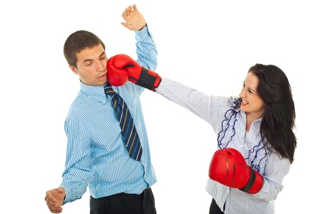 Furious business woman with boxing gloves kick business man isolated on white background photo