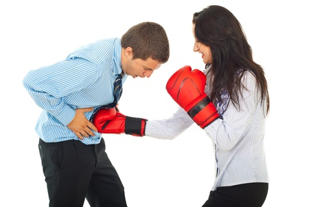 defeat: Powerful business woman with boxing gloves hit stomach  business man isolated on white background