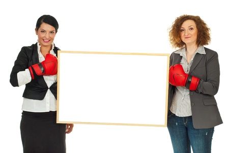 young add: Two business women with boxing gloves holding a blank banner between them isolated on white background