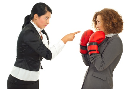 to argue: Manager woman pointing and acussing and employee woman who defending with boxing gloves isolated on white background