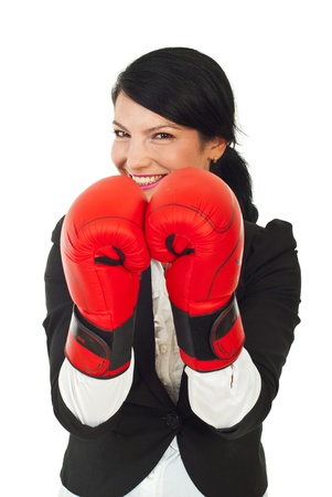 Laughing business woman wearing boxing gloves against white background Stock Photo - 10107748
