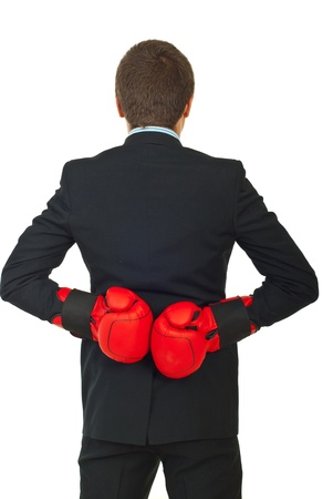 cheater: Back of business man with boxing gloves isolated on white background Stock Photo