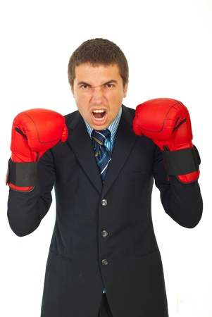 Mad business man with boxing gloves shouting against white background photo