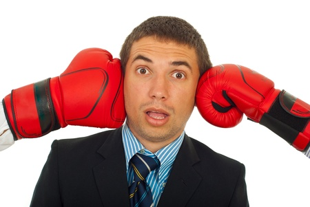 under pressure: Surprised business man with head under pressure isolated on white background Stock Photo