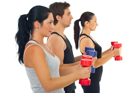Group of three people doing fitness exercises with barbell against white backround