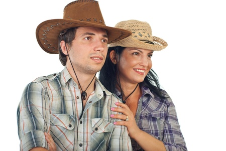 vaqueritas: Pareja feliz, con sombreros de vaquero mirando hacia el futuro aisladas sobre fondo blanco Foto de archivo