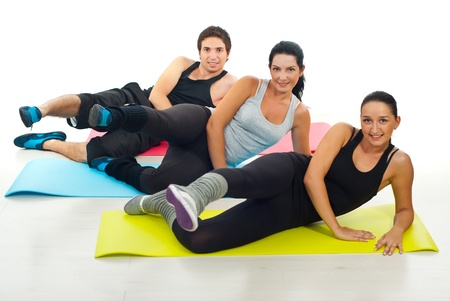 Group of three people doing  fitness exercises,selective focus on woman in gray shirt