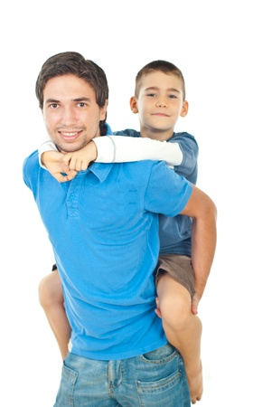 piggy back: Happy father giving piggyback to his son  isolated on white backgorund Stock Photo