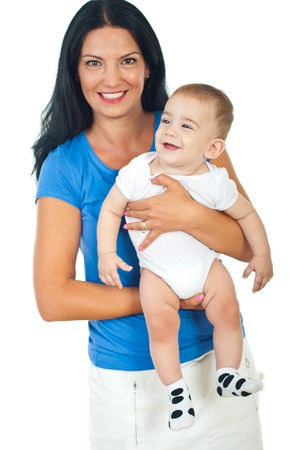 laughing baby: Happy mother holding laughing baby boy isolated on white background