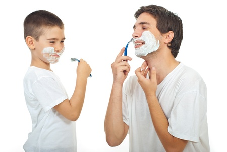 Father teaching his son to shave and havcing fun together isolated on white background
