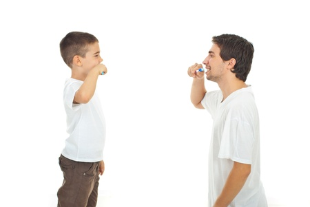 Father teaching his son to brushing teeth isolated on white background