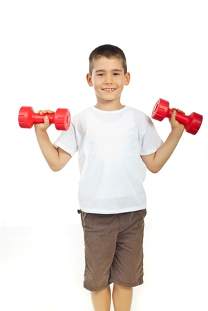 Smiling boy exercising with barbell isolated on white background photo