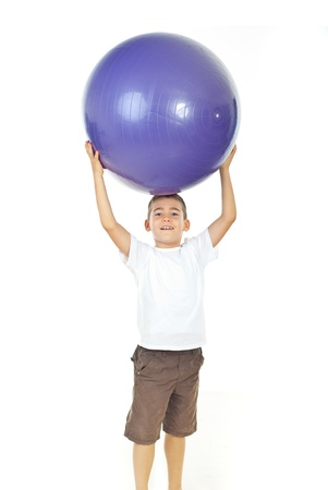 big shirt: Boy holding big mauve ball over his head isolated on white background