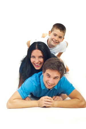 Laughing family having fun and standing  on top each other in their home
