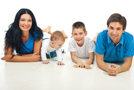 family line: Happy family of four members lying on floor together and smiling against white background