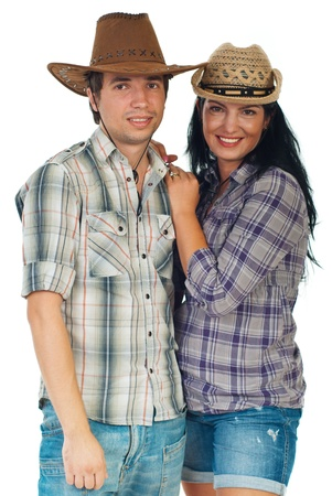 cowgirl and cowboy: Beauty loving couple standingin embrace and wearing cowboy hats isolated on white background